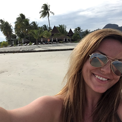 Travel Queen Owner Mel at the tip of Koh Mook Sivalai Resort's private beach peninsula, with the restaurant in the background. Travel Queen