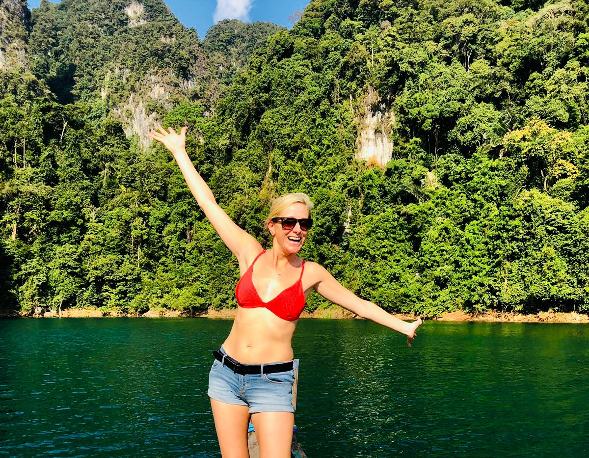 Amy on boat in Khao Sok, Thailand