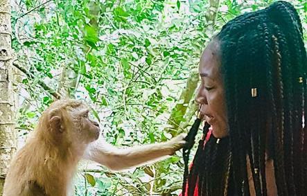Stacey meeting monkey in Phuket, Thailand