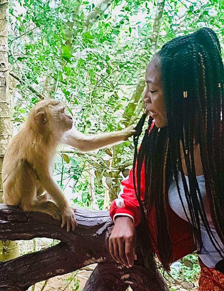 Stacey meeting monkey in Phuket, Thailand