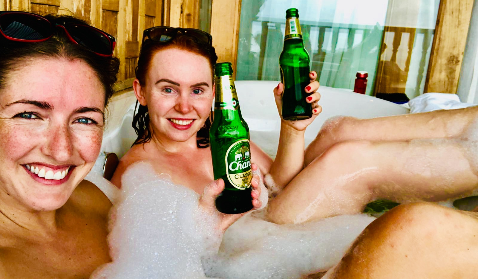 Carly and Bex enjoying Changs in our 5* hotel balcony baths, Koh Yao Yai, Thailand