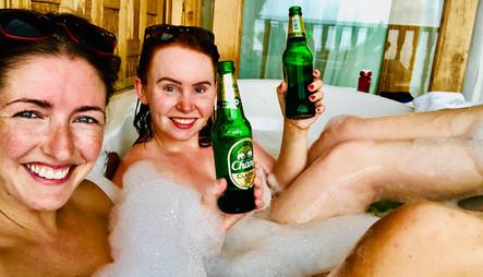 Carly and Bex enjoying Changs in our 5* hotel balcony baths, Koh Yao Yai, Thailand