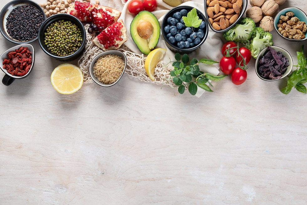Healthy food selection on white wooden background . Fresh fruits , superfoods an vegatable
