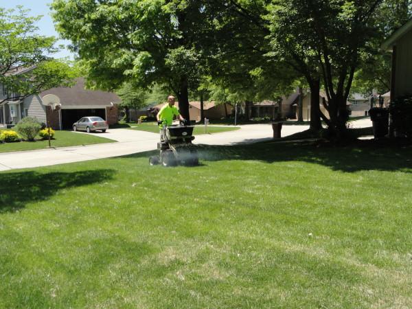 J applying fertilizer.jpg