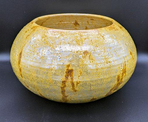 Wide stoneware pot / vase. Lead based titanium glaze.