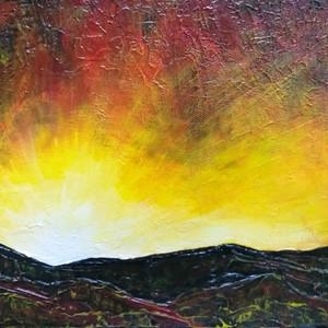 Sunrise through the Mountains