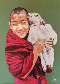 Tibeten boy with baby goat