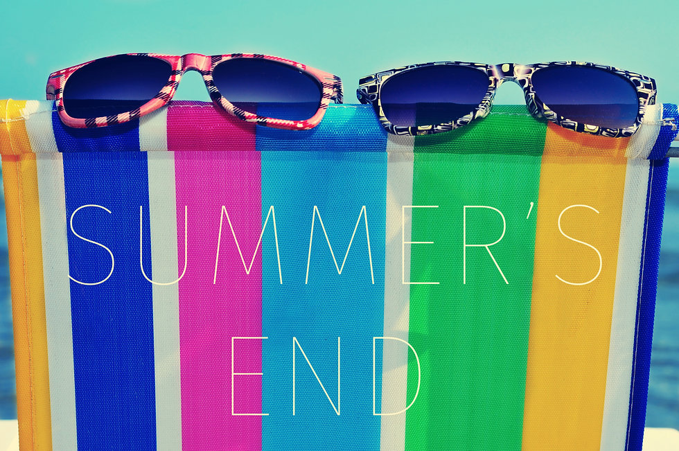 a pair of sunglasses on a colorful deck chair and the text summers end.jpg