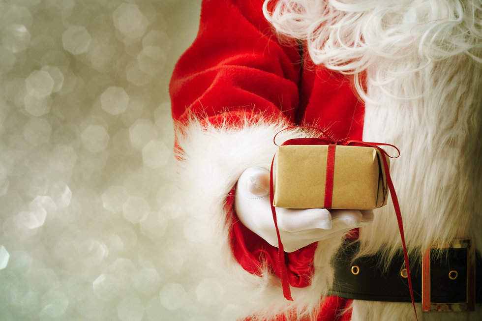 santa claus holding present.jpg