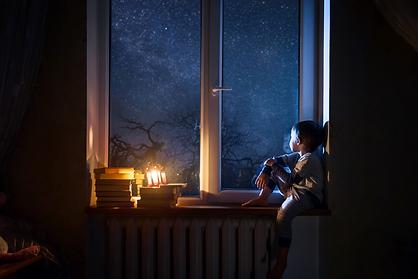 BOY BY THE WINDOW STARS BOOKS NIGHT.png