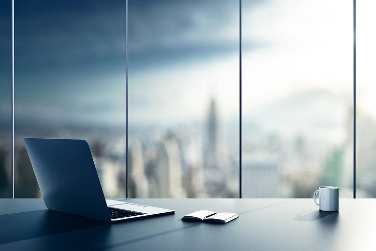 blue desk laptop coffee city view modern