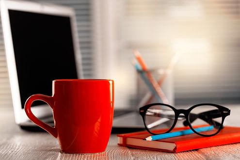 red cup desk laptop glasses.jpg