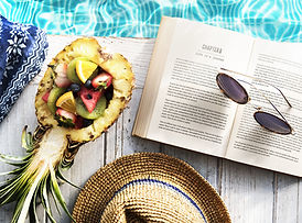reading beach pool food hat glasses book