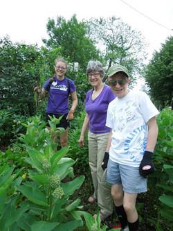 Volunteers helping in the garden