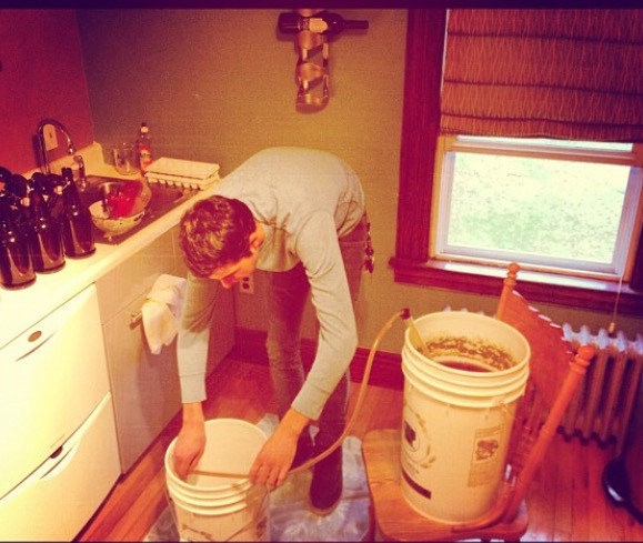 Mike bottling our first batch of beer in 2012.