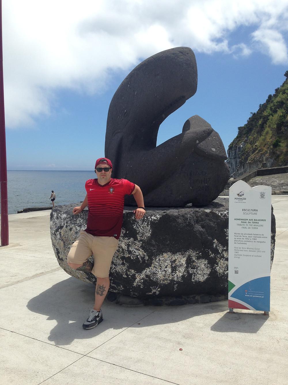 Mark posing at Port Nove, the main whaling boat launch in Faial Da Terra, Portugal