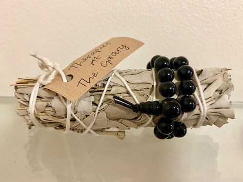 Sage Cleansing Smudge Stick with Black Onyx bracelet attached