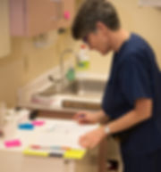 A medical professional looks over note in a clinic.