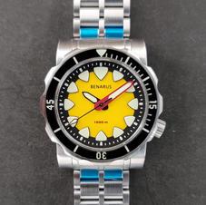 yellow no date sapphire bezel 2.jpg