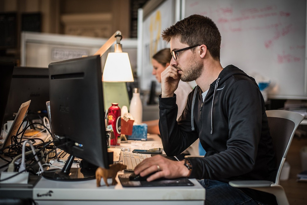 Image of Employee Working at a Computer