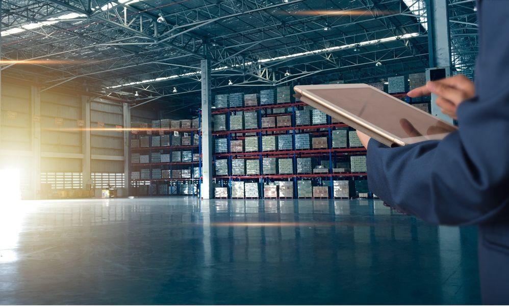 Taking Inventory at Warehouse Image