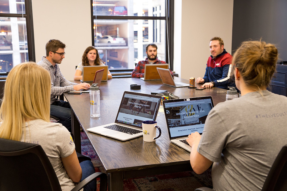 Twelve CG Employees in Conference Room Image