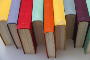 staggered ends of books, spine facing up image