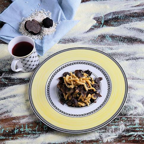 Passatelli with Black Black Truffles and Mushrooms