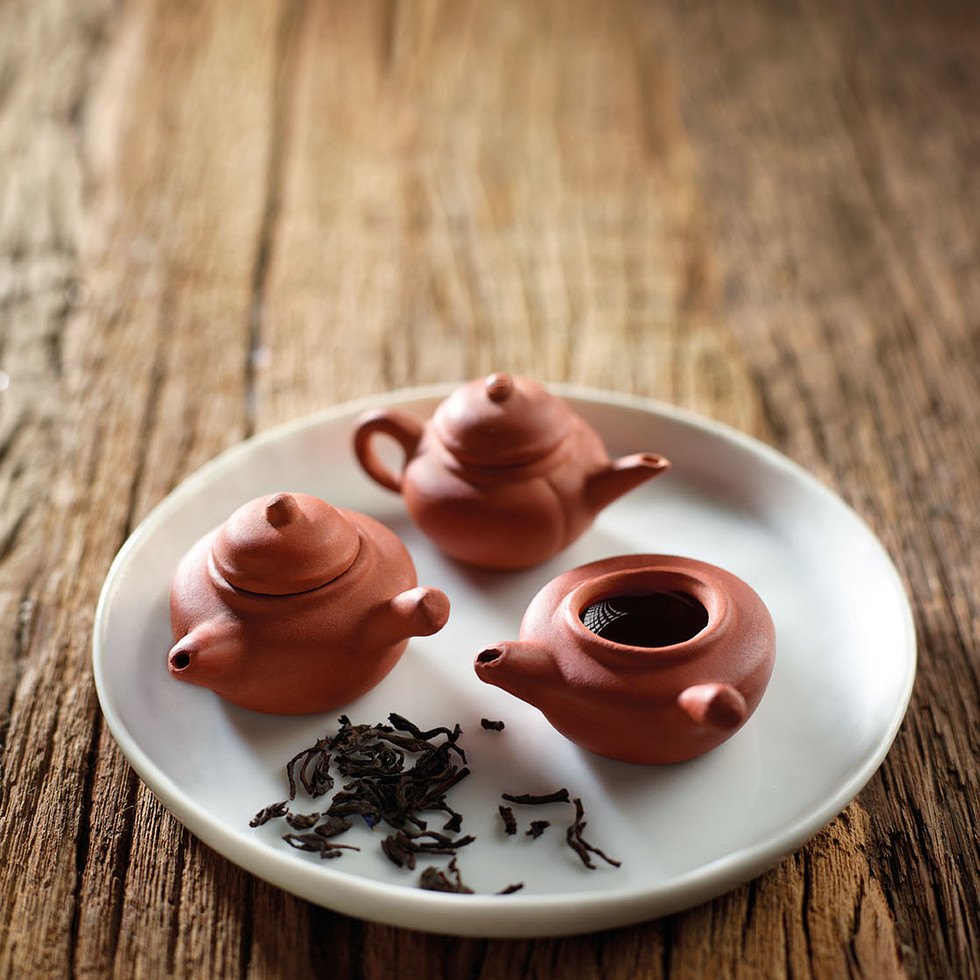 Mini Teapot and Tea Leaves