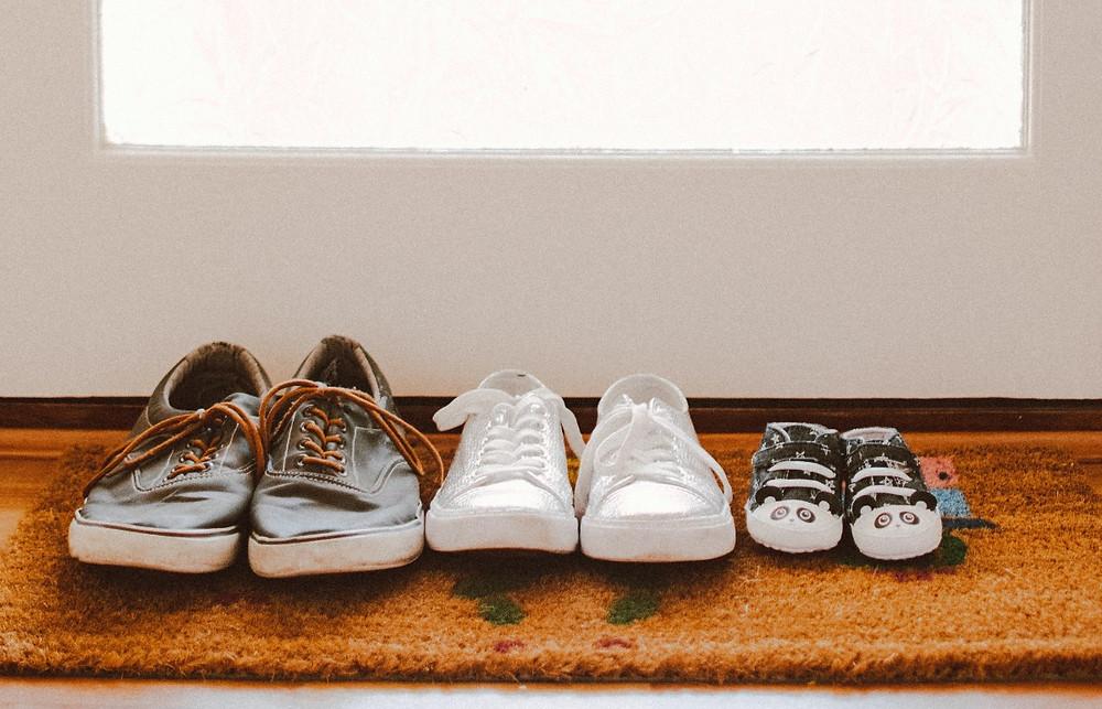 Shoes on door mat, welcome mat