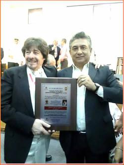 greco with award 1
