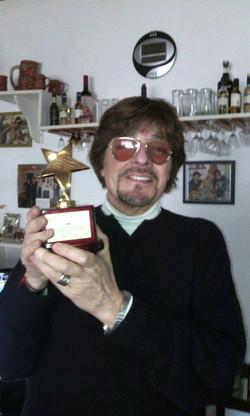 el greco with star trophy