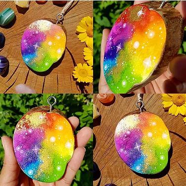 Wood slice rainbow art.