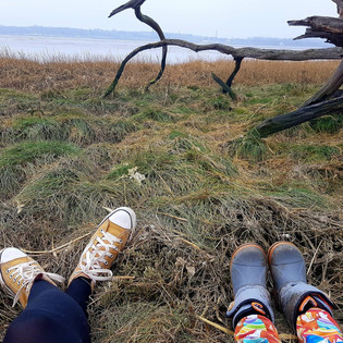 Mine and my sons feet, taking a break down at the estuary.