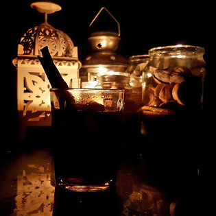 A candle lit glass of mulled wine on a crisp winters evening.