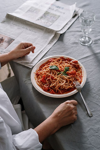 person-having-a-plate-of-spaghetti-for-m