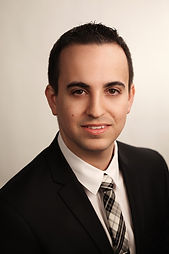 Photo of Attorney Isaac Safier in black suit and black & white tie