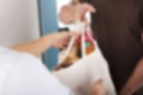 77052582-closeup-of-man-giving-bag-of-gr