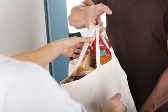 77052582-closeup-of-man-giving-bag-of-gr