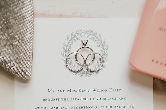A flat lay of invitations and wedding rings in Louisiana