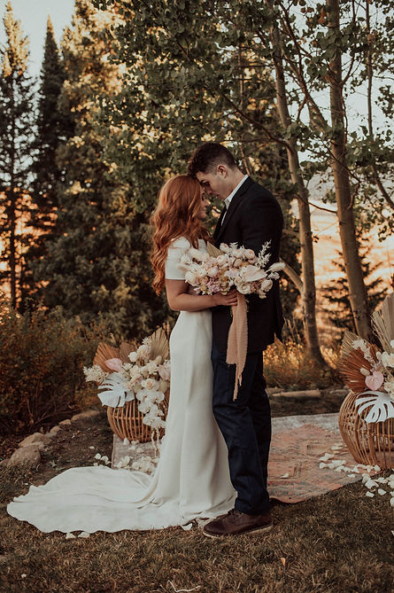 A bride and groom stand in their elopement location to say their vows