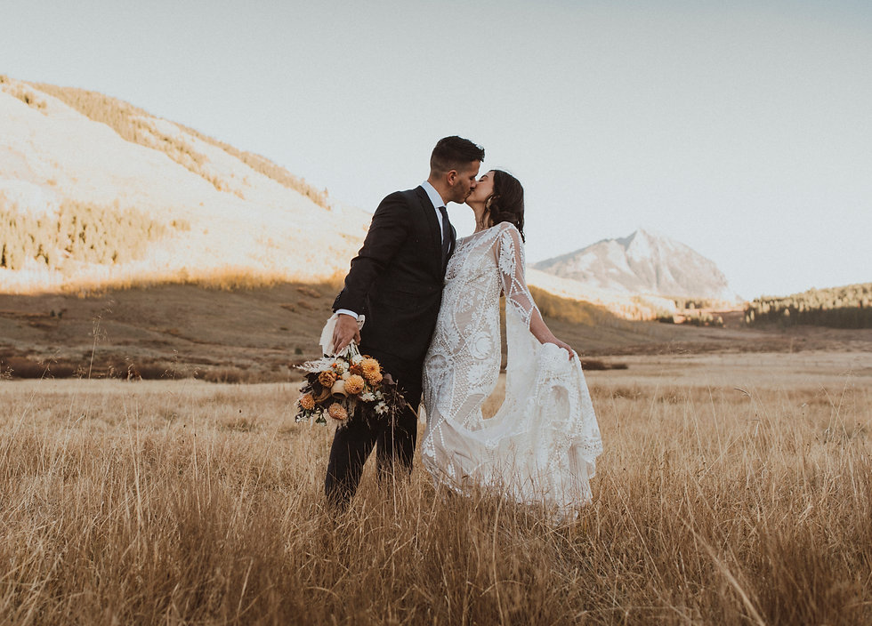 Bride and Groom celebrate after eloping in the mountains