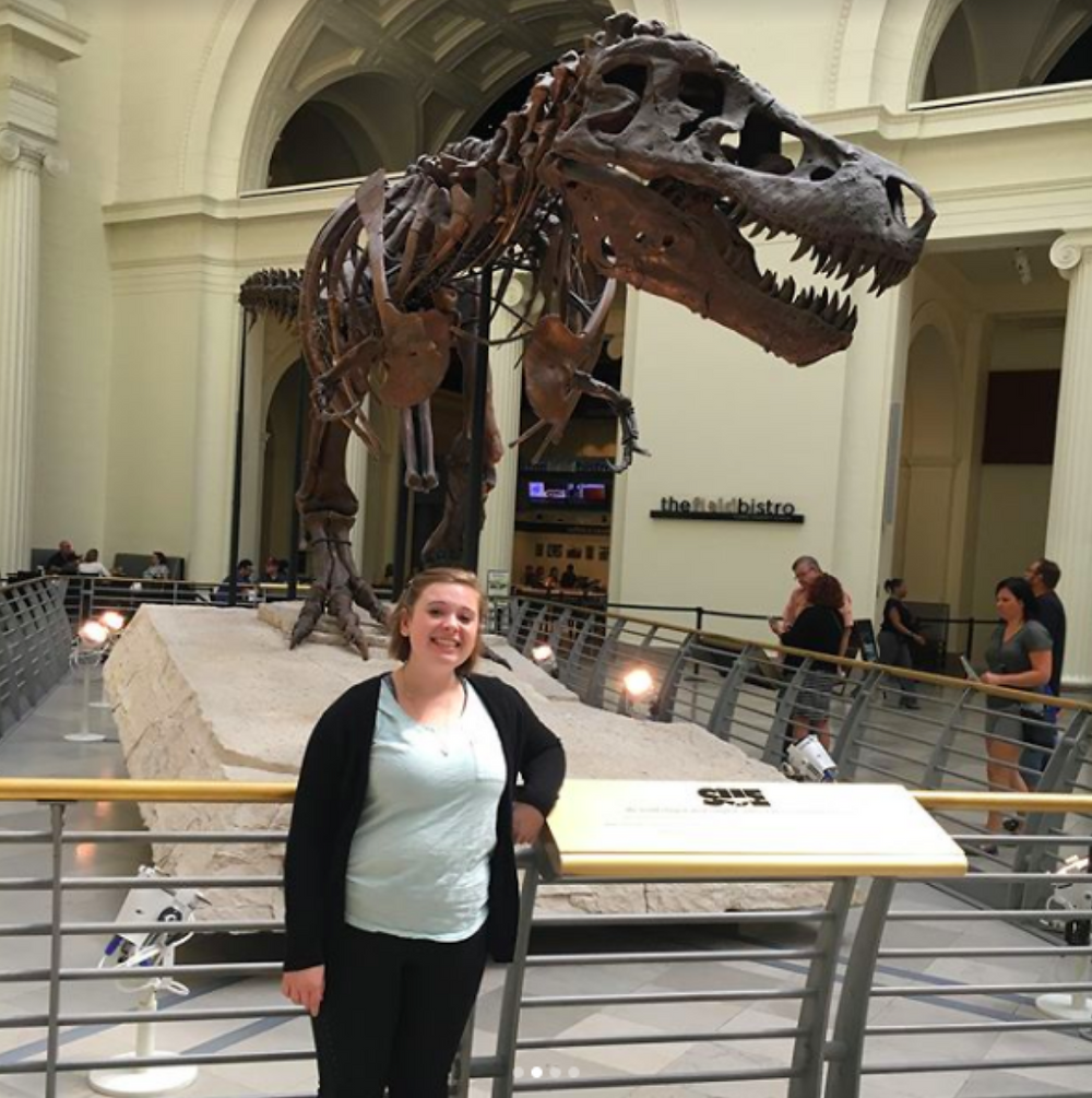 Addy Kirtley pictured with Sue, most complete Tyrannosaurus Rex ever found and you can visit at the Field Museum in Chicago, IL