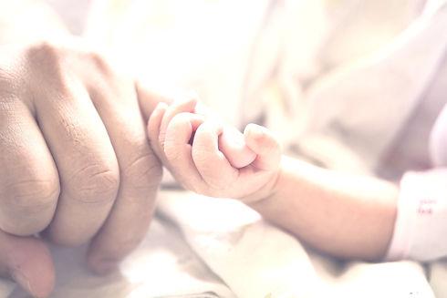 Baby Holding Parent_edited_edited_edited.jpg