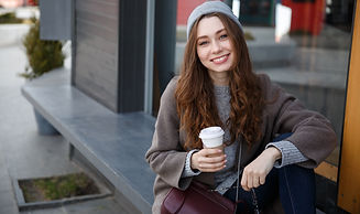 cheerful-woman-sitting-and-drinking-coff