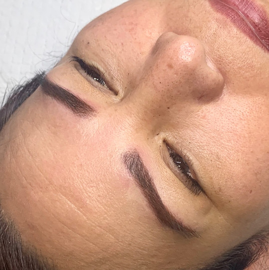 Powder brow tattoo.