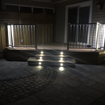 Custom Deck with Regal Rails featuring built in lighting on staircase