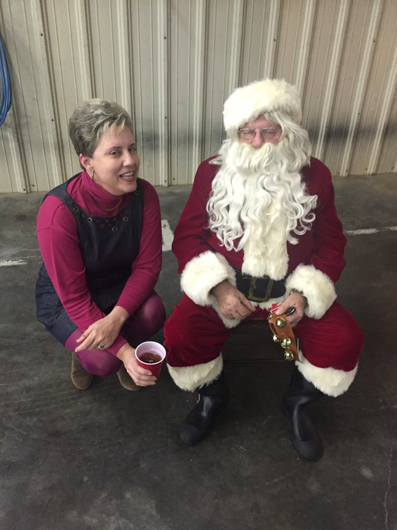 Santa and Gloria chat at the Peachland Volunteer Fire Department