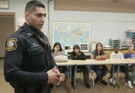 A police officer Abbas Husain talking to eighth graders during community day at Herbert Hoover School in Edison in this 2010 file photo (Alexandra Pais/For The Star-Ledger)