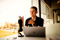 Man presenting podcast with desk mounted microphone